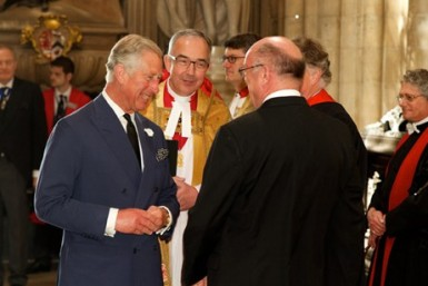 High notes: Prince Charles arrives at the service, on Wednesday